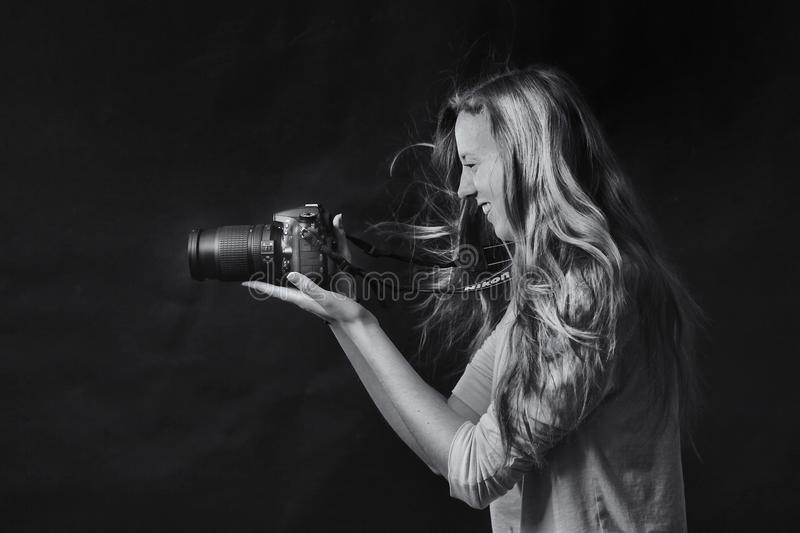 Grayscale Photo of Woman Using Dslr Camera royalty free stock photography