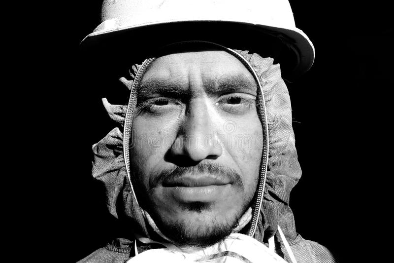 Grayscale Photograph of Man Wearing Hooded Top and Hard Hat stock photos