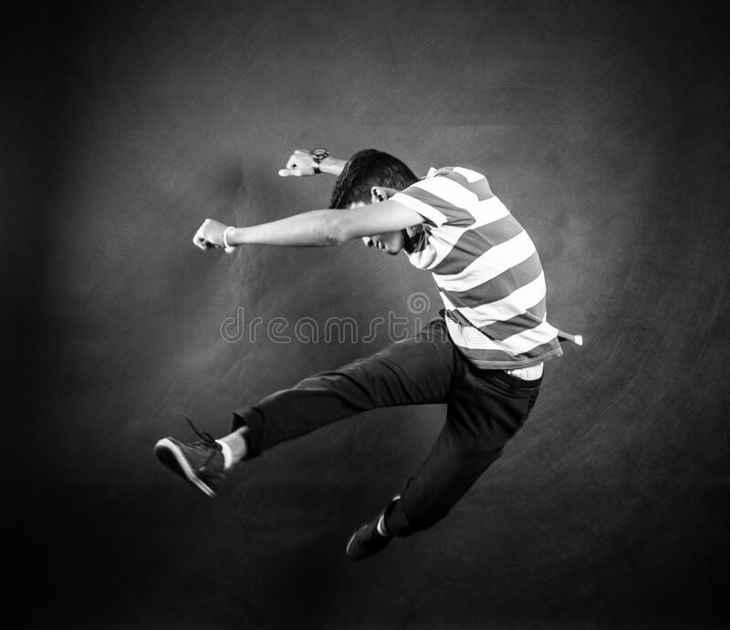 Grayscale Photograph of Man Wearing White and Black Stripe Crew Neck T Shirt stock image