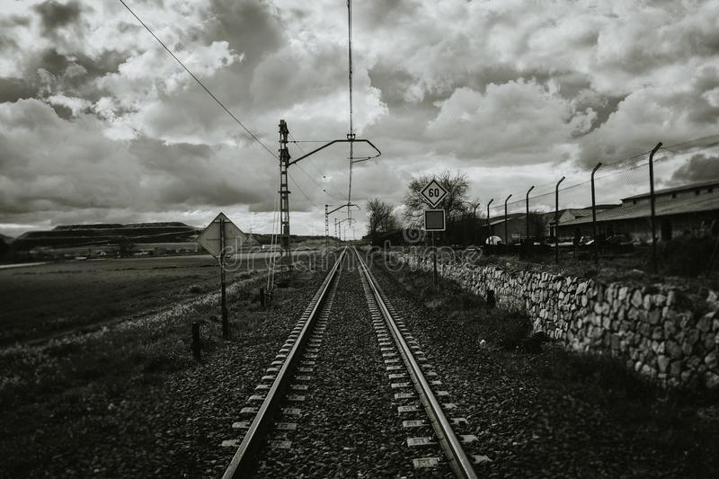 Grayscale Photograph of Train Rail royalty free stock photography