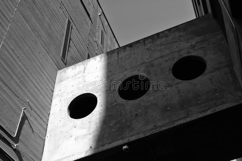 Grayscale Photography of Board With Three Round Holes royalty free stock photos