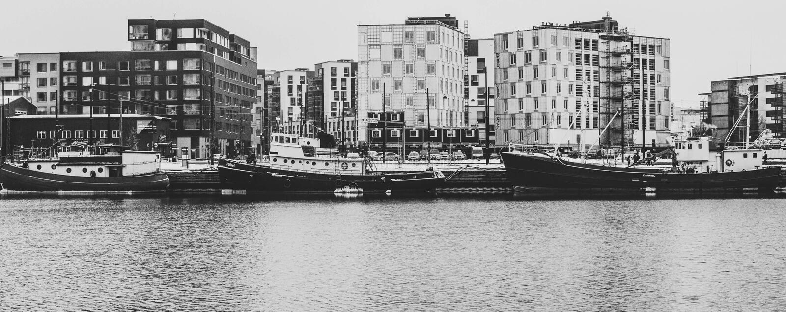 Grayscale Photography Of Buildings And River royalty free stock images