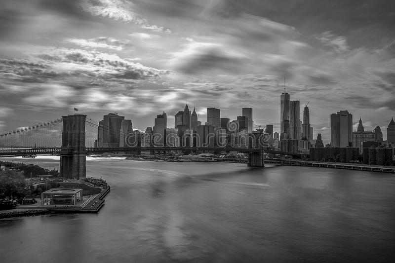 Grayscale Photography of City Buildings and Bridge stock photos