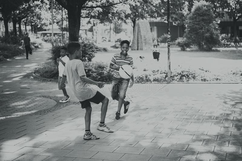 Grayscale Photography Of Kids Playing Ball royalty free stock photo