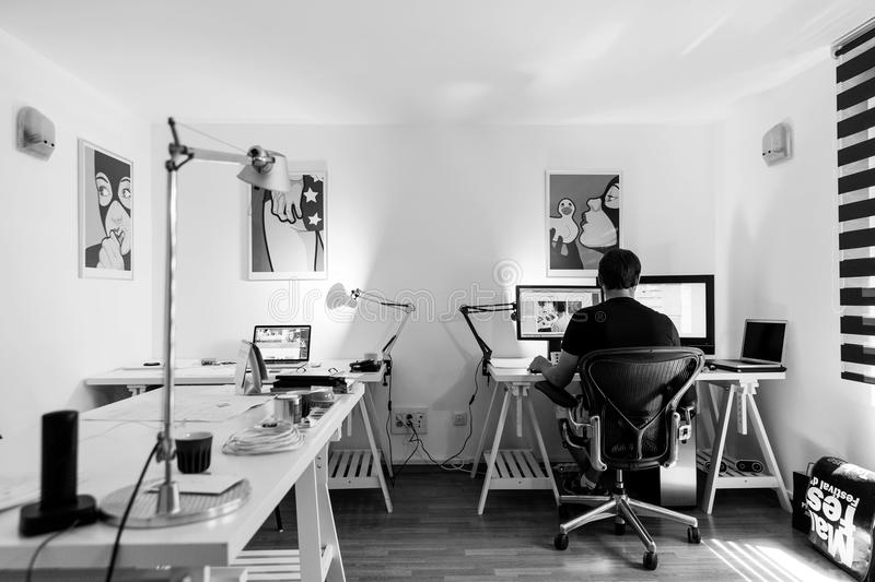 Grayscale Photography Of A Man Sitting Infront Of A Computer Free Public Domain Cc0 Image
