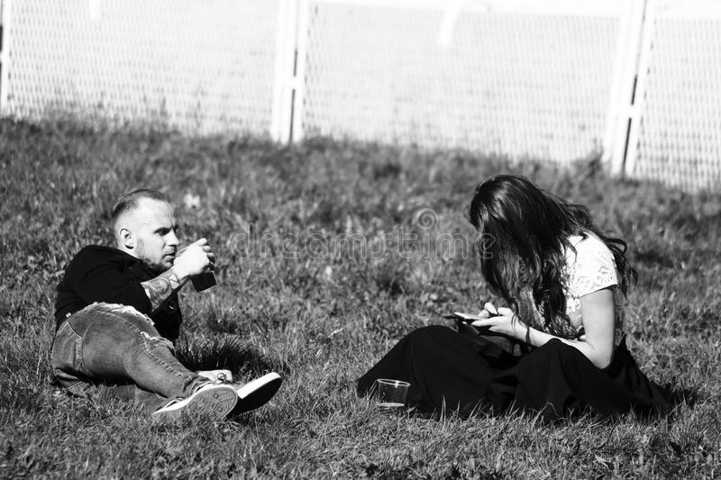 Grayscale Photography of Man and Woman on Grass stock image