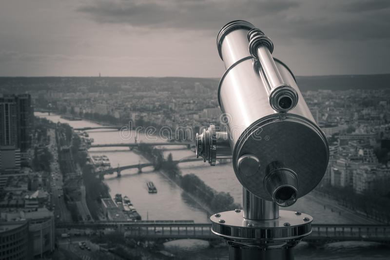Grayscale Photography of Observation Telescope Overlooking City Riverbank royalty free stock photography