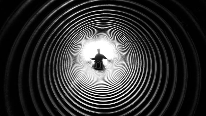 Grayscale Photography of Person at the End of Tunnel stock photo