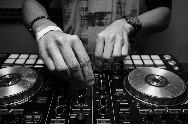 Grayscale Photography of Person Using Dj Controller arkivfoton