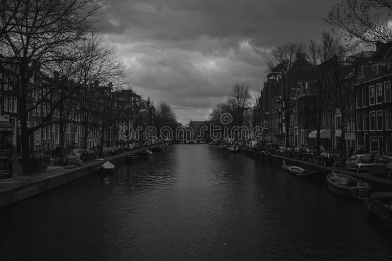 Grayscale Photography of River Near Buildings stock image