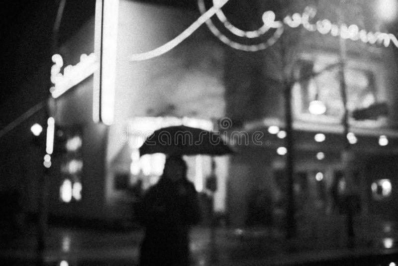 Grayscale photography of a silhouette of a woman holding an umbrella royalty free stock images