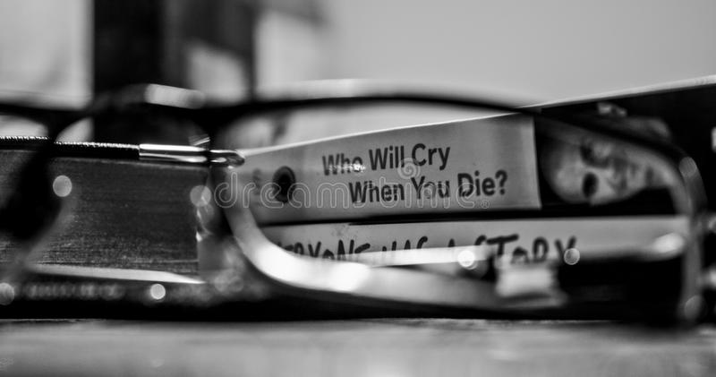 Grayscale Photography View Through Eyeglasses Who Will Cry When You Die? Labeled Book stock photos