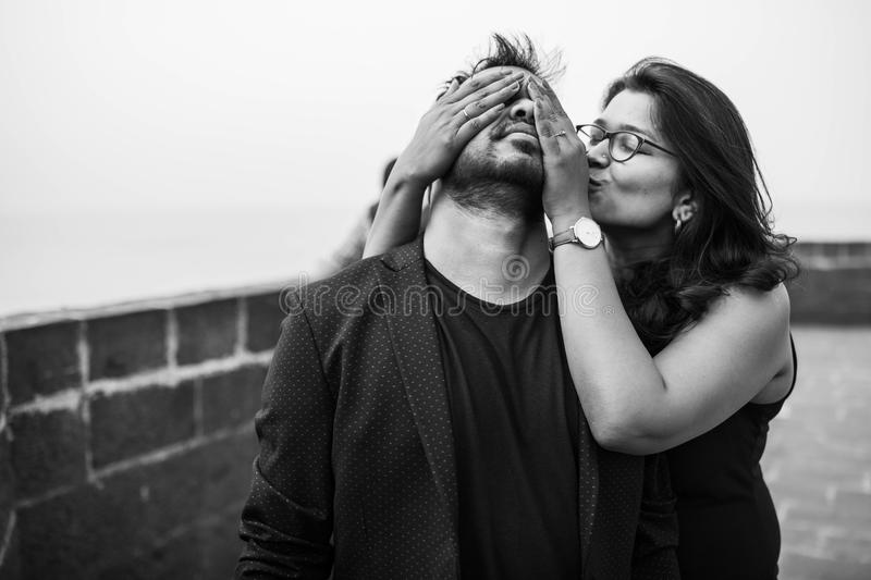 Grayscale Photography of Woman Covering Eyes of Man stock photography