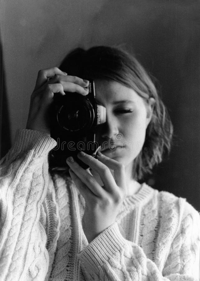Grayscale Photography of Woman Holding Camera stock image