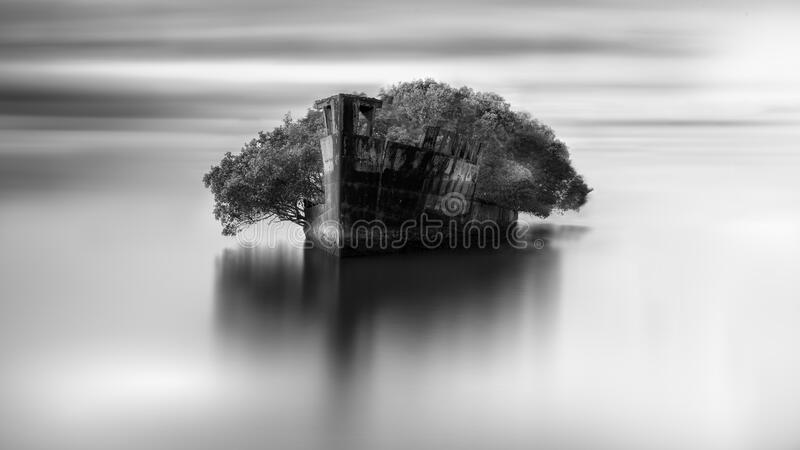 Grayscale shot of an abandoned area in the open sea. A grayscale shot of an abandoned area in the open sea stock images