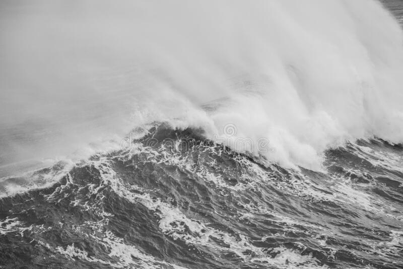 Grayscale shot of a big sea wave. A grayscale shot of a big sea wave royalty free stock image