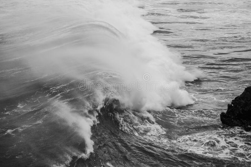 Grayscale shot of a big sea wave. A grayscale shot of a big sea wave stock images