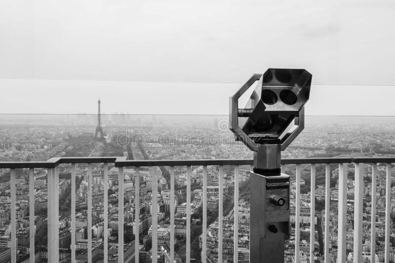 Grayscale shot of a city telescope. A grayscale shot of a city telescope royalty free stock images