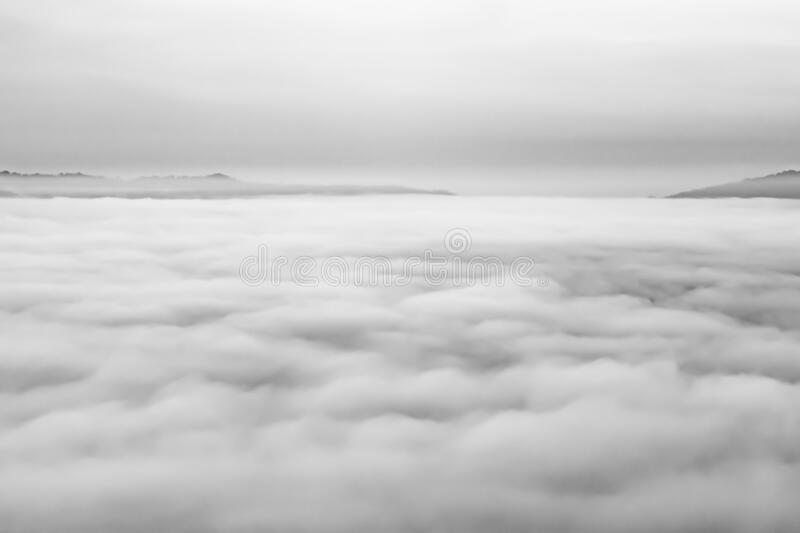 Grayscale shot of foggy. In the morning at Phetchabun Thailand stock image