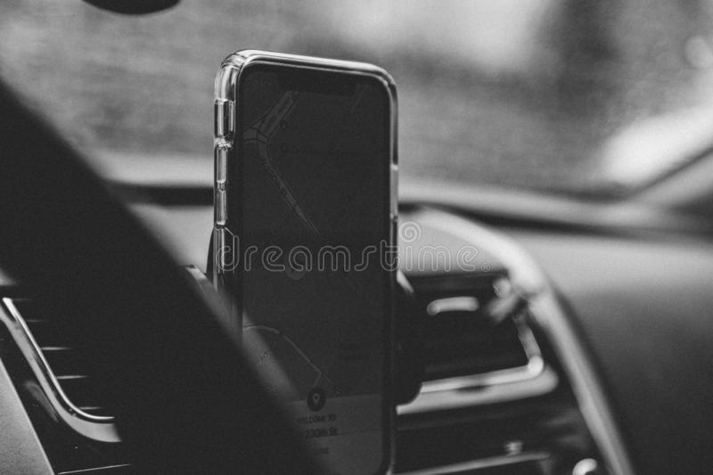 Grayscale shot of a smartphone with GPS on. A grayscale shot of a smartphone with GPS on stock photos