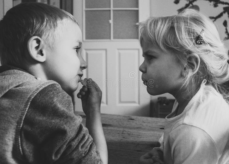 Grayscaled Photo of Boy and Girl stock images