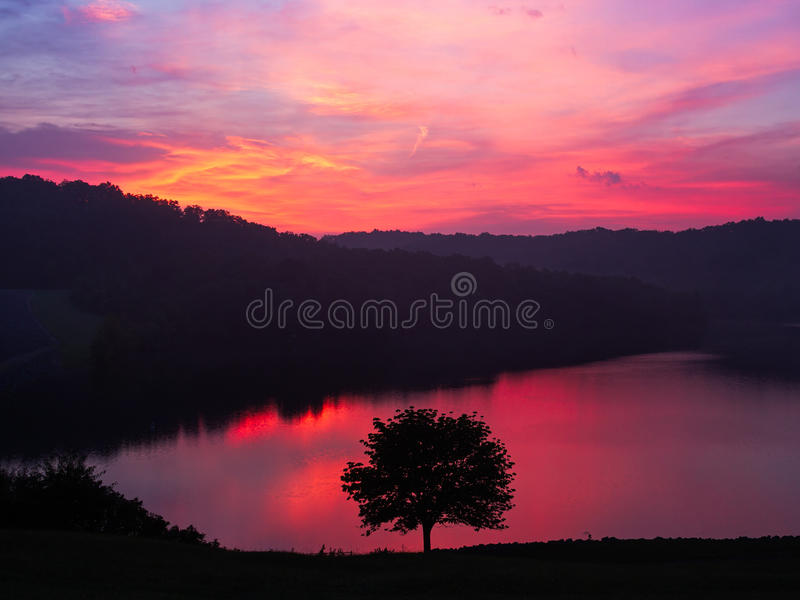 Grayson Lake Dawn. A colorful sunrise sky is reflected on the waters of Kentucky's Grayson Lake reservoir royalty free stock images