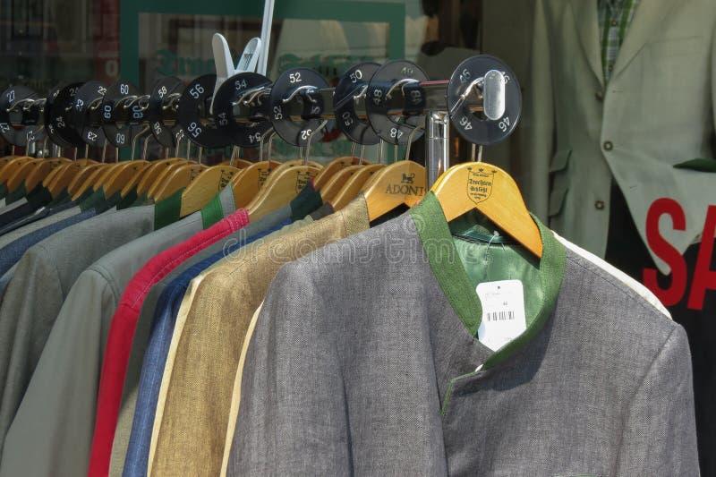 Men suit jackets. GRAZ, AUSTRIA - CIRCA JULY 2015: Row of men suit jackets on hangers royalty free stock image