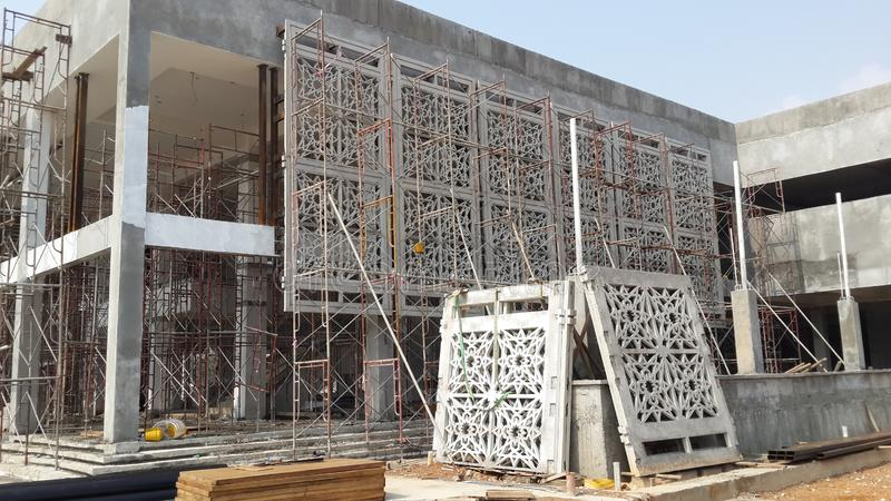 GRC Glass Fibre Reinforce Concrete with Islamic geometry pattern installation work at the construction site royalty free stock photography