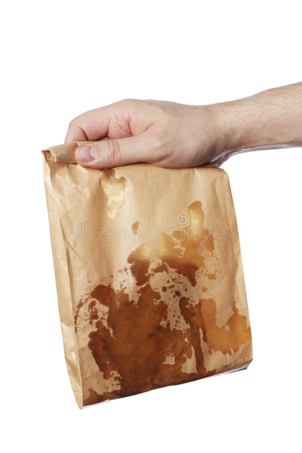 Greasy. Man holding a brown paper bag with very greasy contents royalty free stock photos