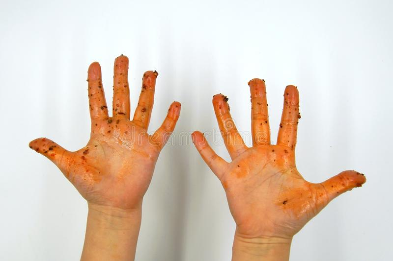 Greasy child hands. Dirty greasy child hands after eating sauced food stock photo