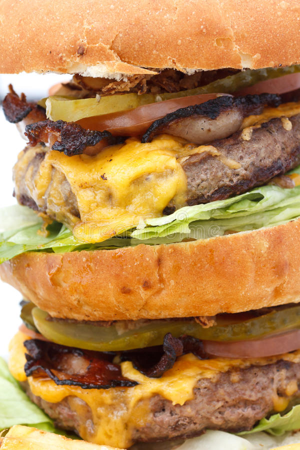 Greasy double cheese burger tower. Detail royalty free stock photography