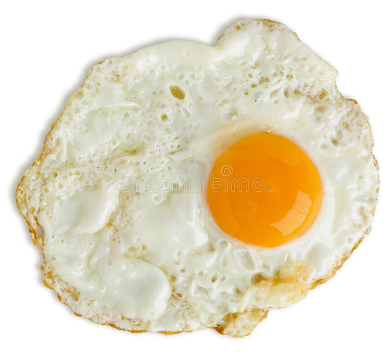 Greasy fried egg. A greasy fried egg on white background royalty free stock photo