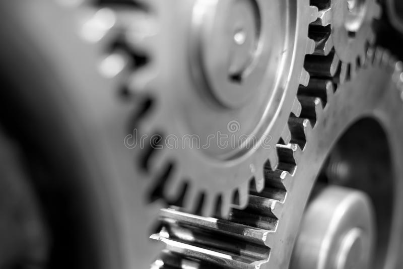 Greasy gears in the machine. Big greasy gears in the old machine stock photo