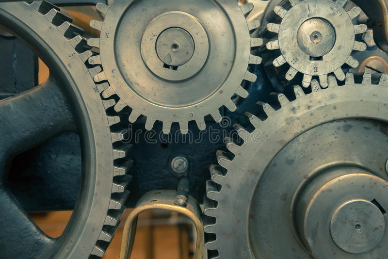 Greasy gears in the machine. Big greasy gears in the old machine stock image