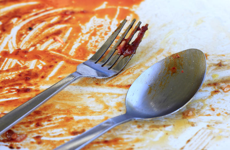 Greasy plate and fork. After eating stock image