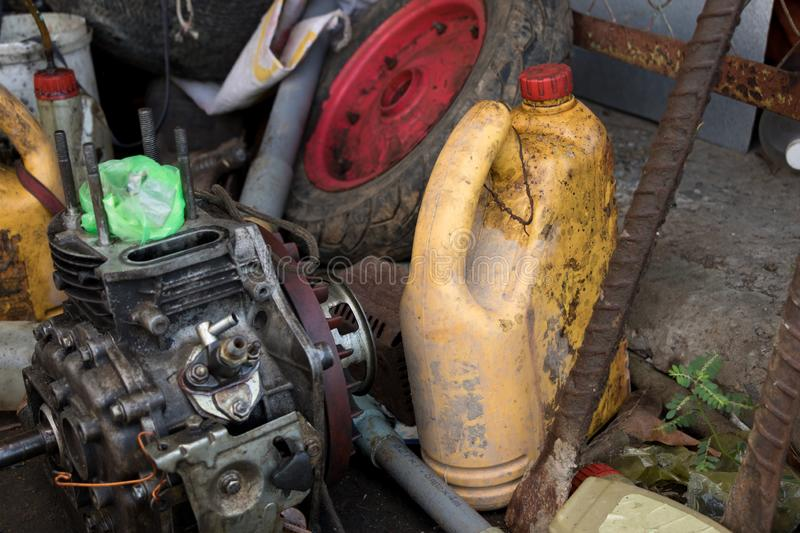 Old Diesel Engine with Empty Machine Oil Bottle and Dirty Wheel - Messy Garage stock photography