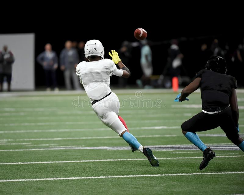 Great action photos of high school football players making amazing plays during a football game. High School football players making great plays during games in stock photos