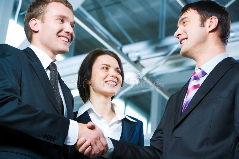 Great bargain. Handshake of business people struck a bargain stock photography