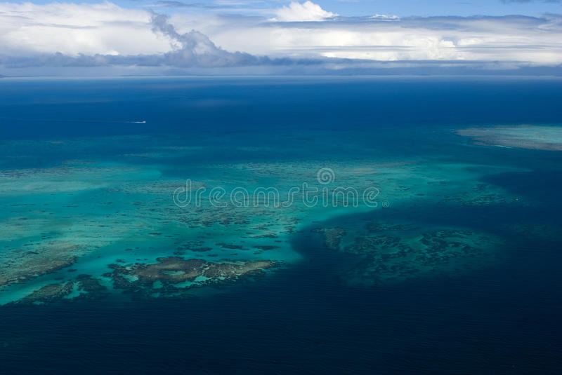 Great Barrier Reef. The Great Barrier Reef is one of the seven wonders of the natural world. The reef contains an abundance of marine life and comprises of over royalty free stock photo