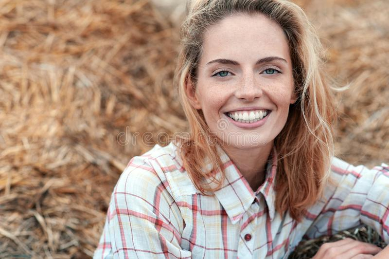 Great beautiful redhead woman in the hay mow royalty free stock photography