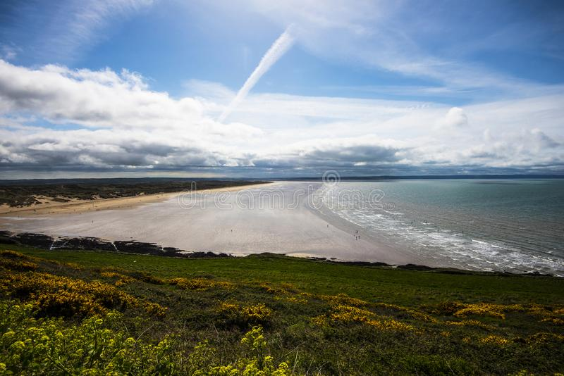 Saunton Sands, Devon, England. The great and beautiful sweep of Saunton Sands is shown here. The beach is very popular with surfers. The area is surrounded with royalty free stock photos