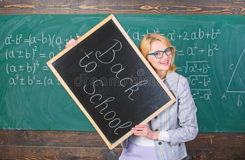 Great beginning of school year. Top ways to welcome students back to school. Teacher woman hold blackboard inscription stock images