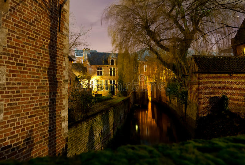 Great Beguinage, Leuven, Belgium at night. The Great Beguinage (Groot Begijnhof) of Leuven, Belgium, at night with a tree and river (Dijle stock images