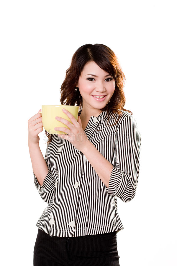 Great beverage time. Young woman holding a big green cup with both hands smiling stock photos