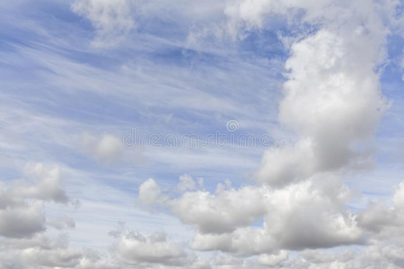 Great blue sky and white wispy clouds 0570. Great blue sky with white clouds background. No people or horizon nothing but sky stock photo