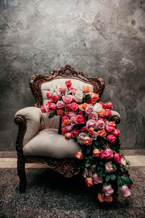 Majestic bouquet over a chair royalty free stock photos
