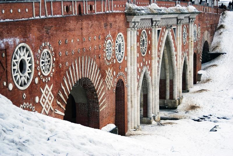 The Great Bridge over the ravine. MOSCOW -- FEBRUARY 18, 2017: The Great Bridge over the ravine. Architecture of Tsaritsyno park in Moscow. Popular touristic stock images