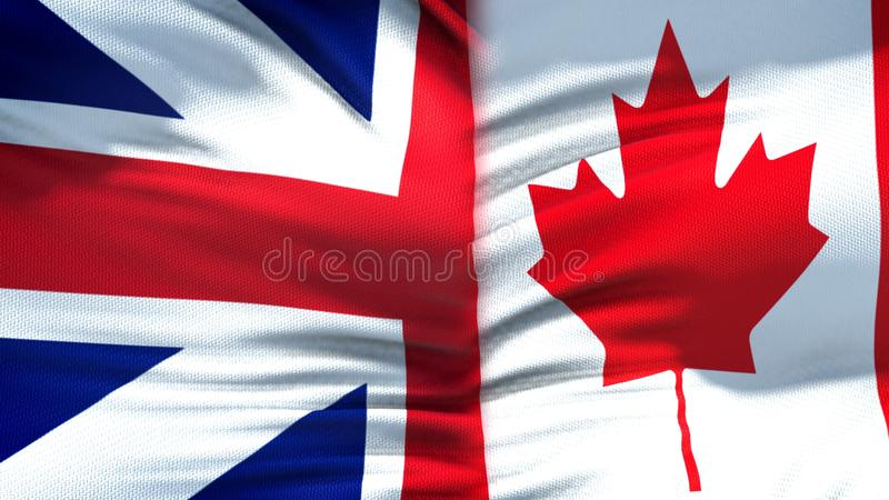Great Britain and Canada flags background, diplomatic and economic relations. Stock photo stock image