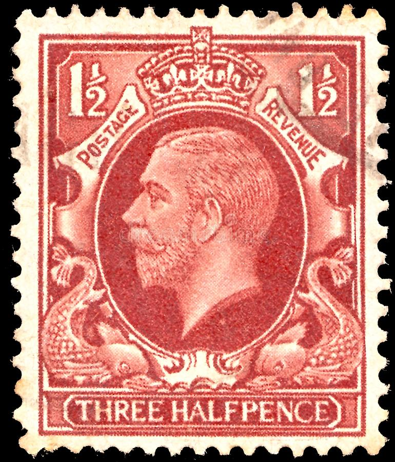 British postage stamp with the image of King George of Great Britain. The brand has the name royalty free stock photo