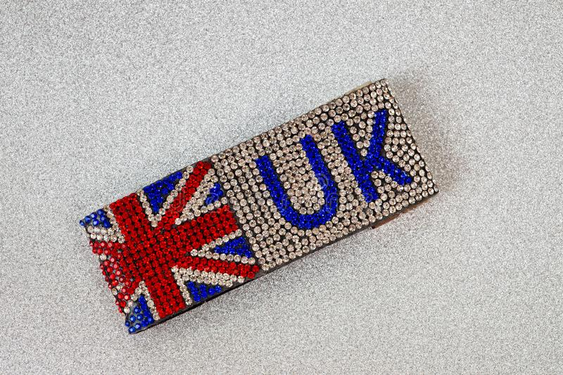 Great Britain flag bracelet inlaid with irregularly shaped stones with incredible brilliance.  royalty free stock image